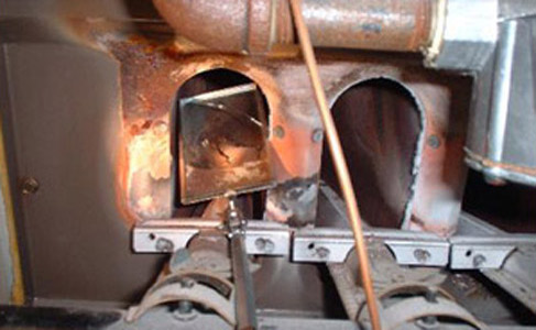 Cracked firebox on an old rusty furnace. Cracked heat exchanger on a furnace. We are furnace heat exchanger experts. Your furnace firebox is in good hands.