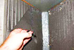 Central air conditioner repair including cleaning the central air conditioning evaporator coil located on top of the central furnace